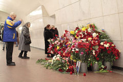 Memories the victim at acts of terrorism. MOSCOW, RUSSIA - MAR 29: Natural flowers in the Moscow underground at station Lubyanka in an anniversary of memory of stock image