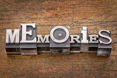 Memories word in metal type. Memories word in mixed vintage metal type printing blocks over grunge wood Stock Image