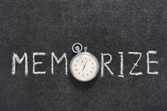 Memorize word watch. Memorize word handwritten on chalkboard with vintage precise stopwatch used instead of O Royalty Free Stock Images
