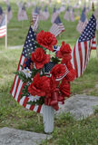 In Memory. Flowers are placed by a grave sight of a loved one in a Veteran's Cemetery Stock Photo