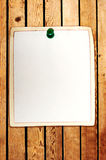Memory. Clean paper sheet attached to the wooden background Stock Image