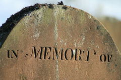In Memory. Close up of head of tombstone with inscription - in memory of Royalty Free Stock Photos