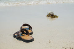 Memory. The memory, Abstract of memory , Abstract of leaving, Shoes on the beach Royalty Free Stock Image