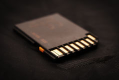 Memory card on a black Stock Image