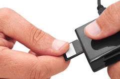 Memory card and reader. Someone inserting a memory card into a memory card reader Royalty Free Stock Photo