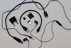 Memory cards, usb connectors, earphone jack plug and wires studio  on white Stock Image