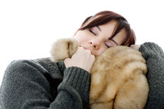 Memory of childhood. Adult girl is hugging big soft toy Stock Image