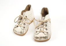 Worn baby shoes. Memory of a childhood, old worn baby shoes Royalty Free Stock Image