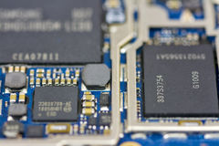Memory chips in a cell phone board. Miniature circuit board with computer chips on it royalty free stock photo