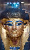 Memory of the Egyptians. An Egyptian mask preserved in the Egyptian museum with all its splendor and its golden color that joins the blue on the eyes brings to Stock Photos