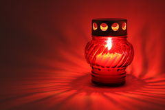 Memory lantern. With alight candle in the dark Stock Image