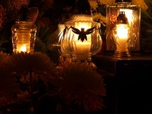 Memory and light. Candles and flowers, symbols of remembrance of the dead Royalty Free Stock Images