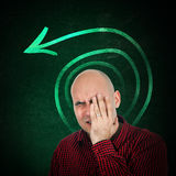 Memory loss. Portrit of adult bald man trying to remember something, hand on face Stock Images