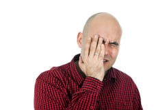 Memory loss. Portrit of adult bald man trying to remember something, hand on face Stock Photography