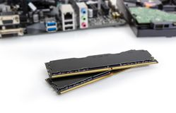 Memory modules of a desktop computers against of other component. Two DDR4 SDRAM memory modules used in the desktop computers, workstations and servers at royalty free stock image