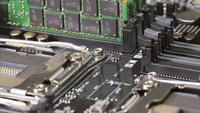 Memory modules (RAM) and CPU socket on server main board stock video footage