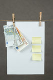 Memory note paper with Euro moneys hanging on cord Stock Images