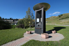 Memory of Olympic Games in Chamrousse Resort. CHAMROUSSE, FRANCE, August 20, 2015 : At the entrance of the mountain resort of Chamrousse, a stele commemorates Royalty Free Stock Photos