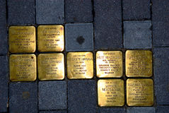 Memory Plates. In the pavement in front of a residential house in Constance, South-Germany, informing about the fates of its Jewish residents during the Nazi Royalty Free Stock Photos