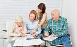 Memory training as dementia prevention. Family with seniors couple together makes memory training as dementia prevention royalty free stock images