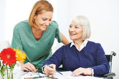 Memory training in nursing home. Old women in wheelchair doing memory training in a nursing home Royalty Free Stock Image