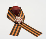 Memory of war. Burning candles Ribbon of Saint George and the Order of the Patriotic War Stock Photos