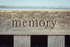 Memory. The word memory carved into a wooden bench Stock Photography