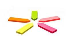 Memos. The photo shows coloured memo pads showing like arrows in the middle Royalty Free Stock Photos