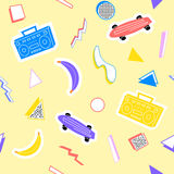 Memphis pattern with geometry skateboard recorder. Memphis pattern with geometry, tape recorder, bananas, skateboard, on a yellow background Royalty Free Stock Photo