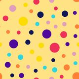 Memphis style polka dots pattern on yellow. Memphis style polka dots pattern on yellow background. Pleasing modern memphis polka dots creative pattern. Bright Stock Images