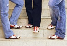 Men's feet in red sneakers Stock Photo