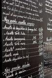 Menú del restaurante en París Imagenes de archivo