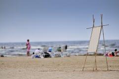 Menüvorstand auf Sand Stockfoto