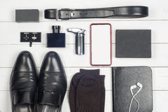 Men accessories. Black elegant accessories pieces isolated on white wooden table. Top view Royalty Free Stock Photo