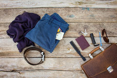 Men accessories and clothing. On wooden background. Top view Royalty Free Stock Photo