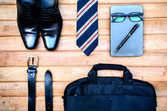 Men accessories on old wooden, Business themes Royalty Free Stock Image