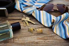 Men accessories: sunglasses, tie, cufflinks, strap, keys, perfume Royalty Free Stock Photography