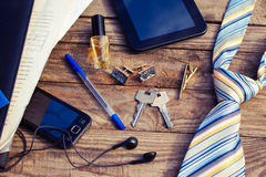 Men accessories: tie, cufflinks, tablet, perfume, pen, mobile phone, headphones, folder of documents and keys Stock Photography