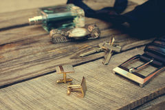 Men accessories: wrist watch, cufflinks, strap, keys, tie, perfume Stock Photography