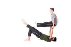 Men in Acro Yoga pose Stock Photos