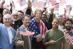 Men With American Flag. Large group of men holding American flag Royalty Free Stock Photo