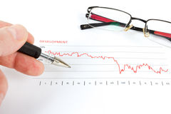 Men analyzing business graph with glasses Royalty Free Stock Images