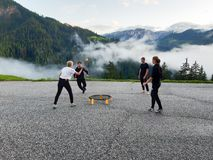 Free Men And Women In Their Twenties Playing A Game Of Spike Ball In A Mountain Parking Lot In The Dolomites Stock Photography - 163548432