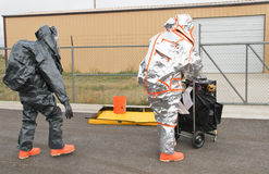 Men approaching hazmat site Stock Photography