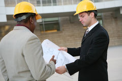 Men Architects. Handsome men working as  architects on a construction site Royalty Free Stock Image