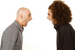 Men arguing. Side view of two young men, one with bald head and one with afro hairstyle, arguing. White studio background royalty free stock images