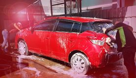 Men Asia are washing car with foam. Royalty Free Stock Images