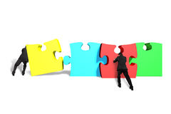 Men assembling puzzles. Isolated in white background Stock Images