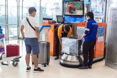 Free Men At Airport Luggage Wrapping Station Wrap Customers` Box Whil Stock Images - 121845874