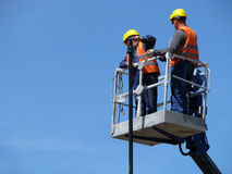 Free Men At Work On The Lifter Royalty Free Stock Photos - 70401318
